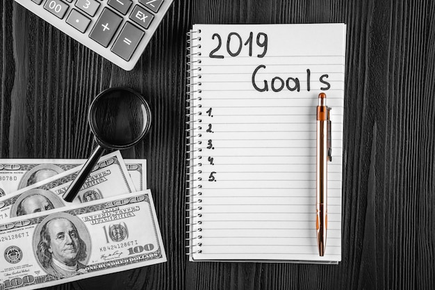 2019 goals on his notebook. new year resolutions concept. top view. Premium Photo