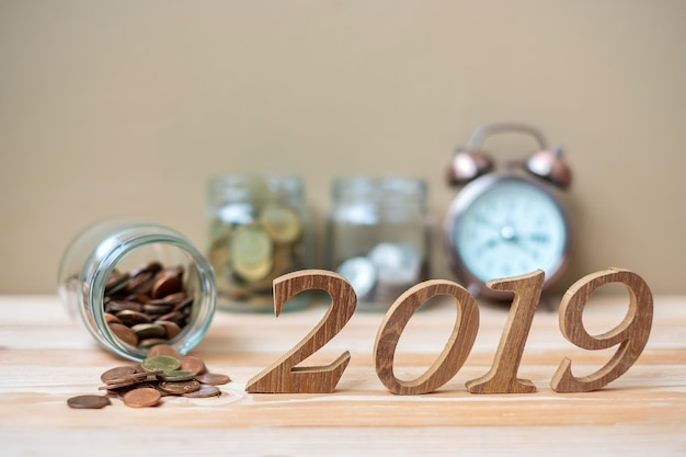 2019 happy new year with gold coins stack and wooden number Photo