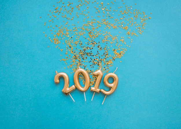 2019 inscription from candles with spangles Free Photo