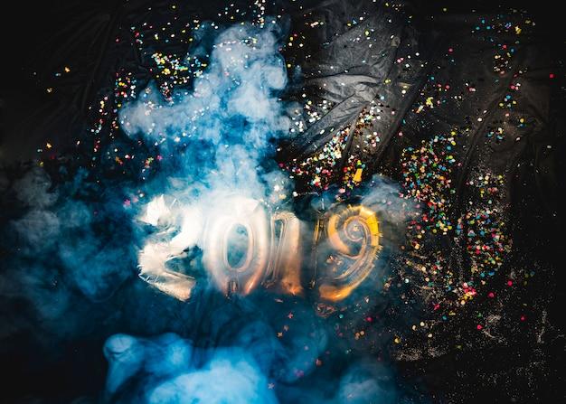 2019 new year balloons in smoke Free Photo