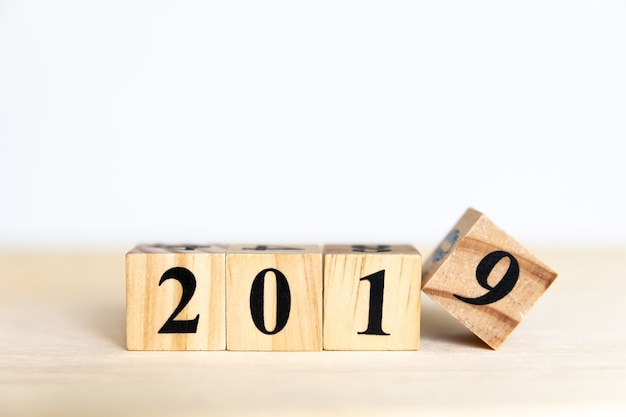2019 new year concept design with wooden cube  on floor and white background Premium Photo