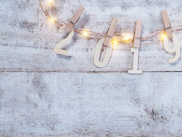 2019 new year wooden number on wood background Premium Photo