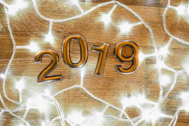 2019 numbers between illuminated fairy lights Free Photo