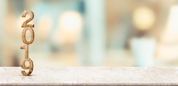 С новым годом 2019 на мраморном столе с мягкой боке стены Premium Фотографии