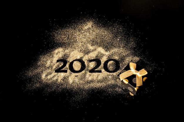 新年あけましておめでとうございます2020。数字2と0の創造的なコラージュは2020年を構成しました。黒に美しい輝く黄金の数2020 Premium写真