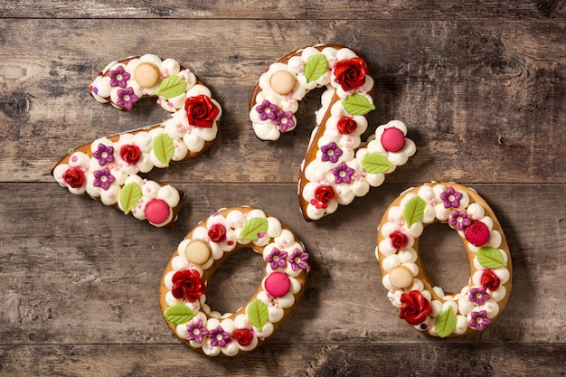 2020 cake on wooden table new year concept. Premium Photo