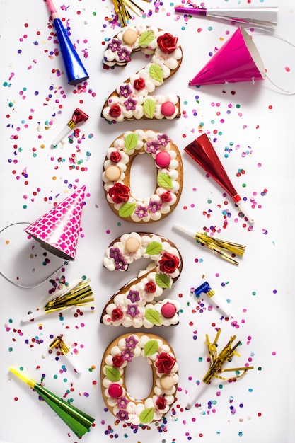 2020 cakes and ornaments on white surface Premium Photo