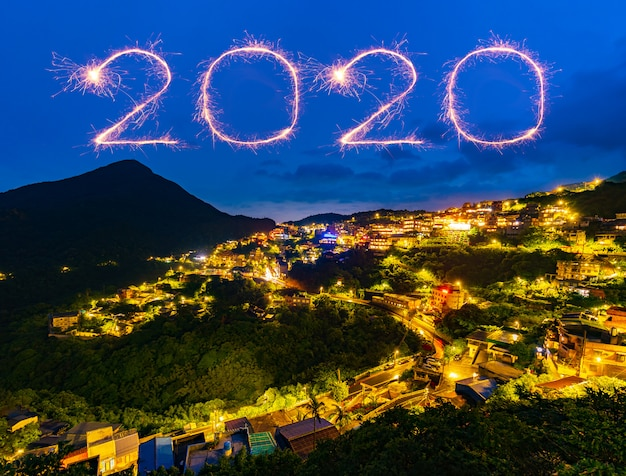 2020 happy new year fireworks over jiufen old street city at night, taiwan Premium Photo