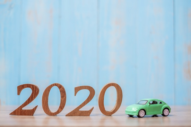 2020 happy new year with car on wood table with copy space Premium Photo