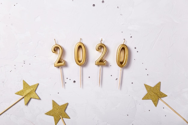 2020 holiday candles as a symbol of the new year Premium Photo