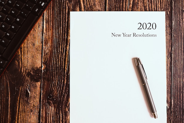 2020 new year resolutions written on a blank sheet. Premium Photo