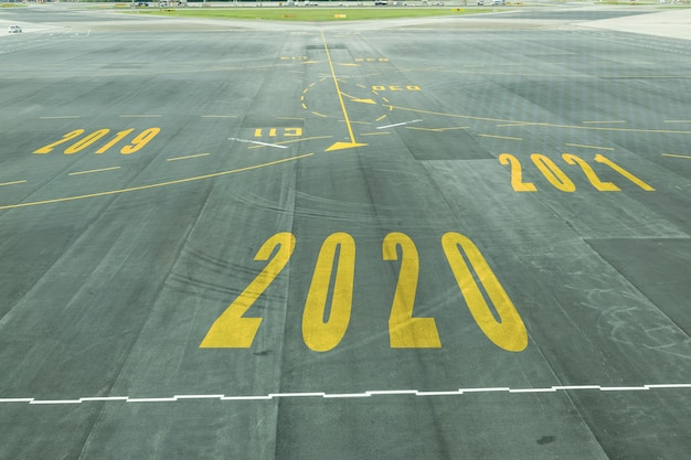 The 2020 number sign on the airport runway shows the coming new year's reception soon. Premium Photo