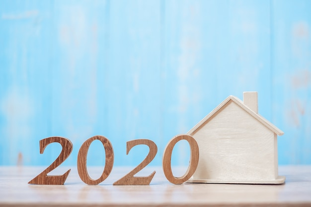 2020 number with house model on wood Premium Photo