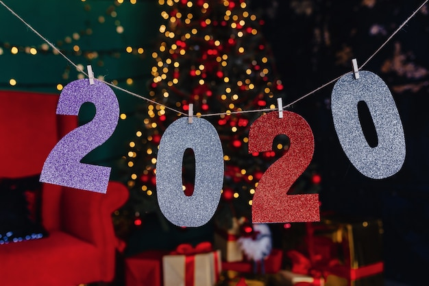 2020 numbers new year party, christmas tree Premium Photo