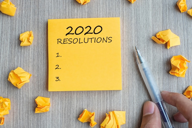 2020 resolutions word on yellow note Premium Photo