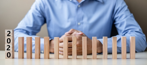 2020 wooden blocks. business, risk management, resolution Premium Photo
