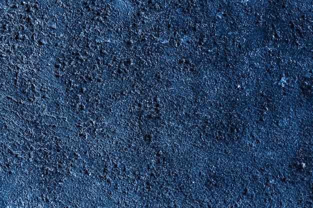 Цвет 2020 года - классический синий. текстурированный фон Premium Фотографии