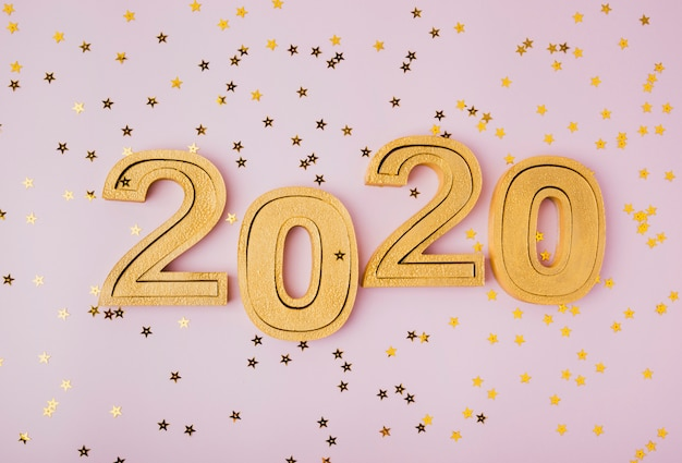 Празднование нового года 2020 и золотой блеск звезд Бесплатные Фотографии