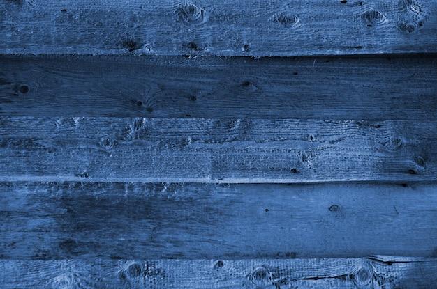 Синяя текстура древесины с естественными узорами. классический синий цвет. цвет 2020 года. модный цвет. Premium Фотографии