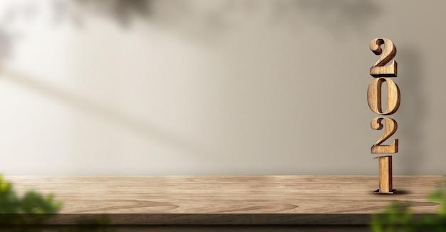 2021 с новым годом дерево на фоне деревянного стола с солнечным светом и растением Premium Фотографии