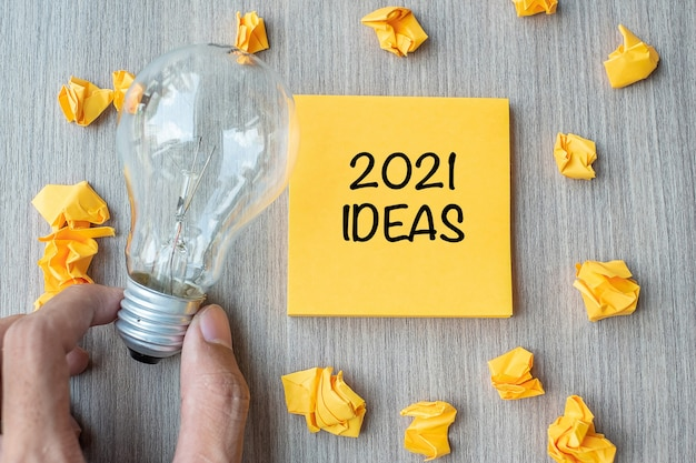 2021 idea words on yellow note and crumbled paper Premium Photo