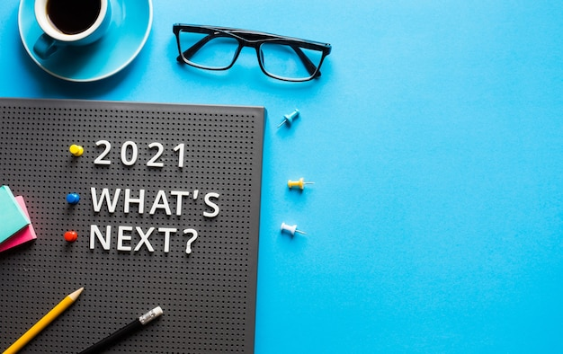 2021 what's next ? text on work table.trends research and new things.business startup concepts Premium Photo
