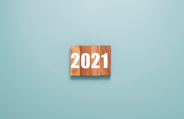 2021year printed on wooden cubes block. merry christmas and happy new year concept. Premium Photo