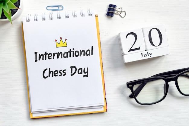 20th july international chess day - twentieth day month calendar concept on wooden blocks. Premium Photo