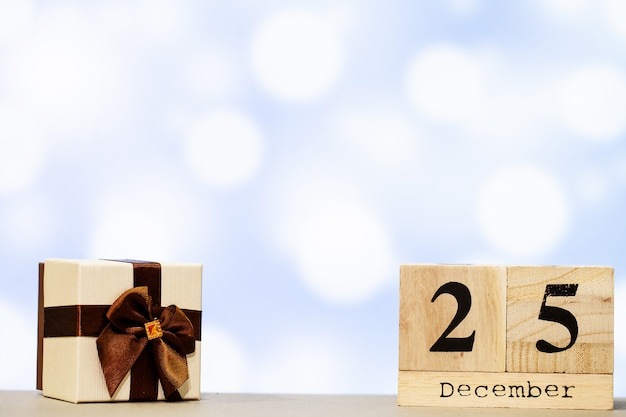 25 december and christmas decoration on blue background Premium Photo
