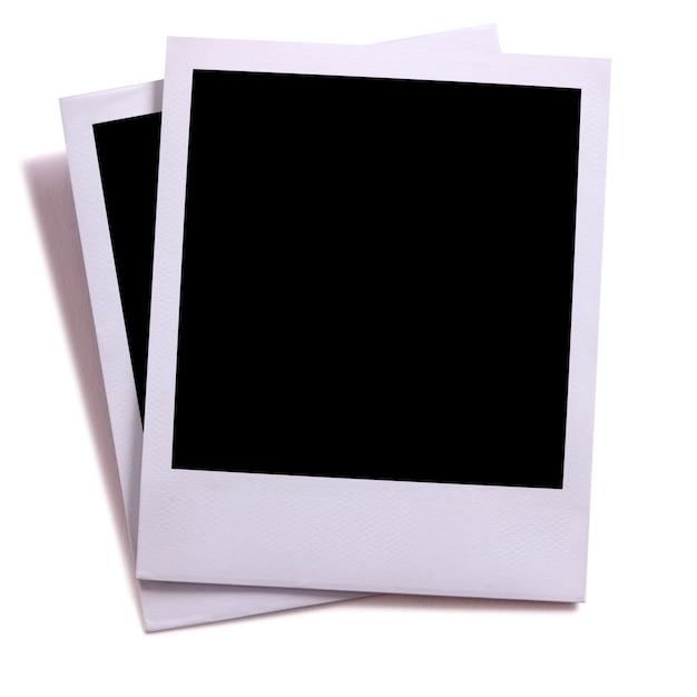 2つの空白のインスタントカメラの写真プリントは、白のシャドーで隔離されて Premium写真
