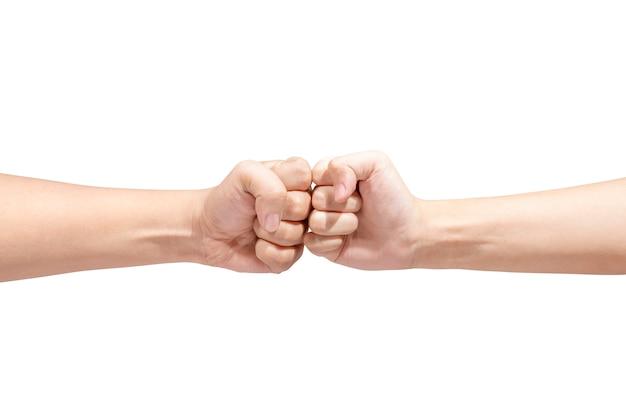 拳をポンプでくむ2人の男性の手 Premium写真