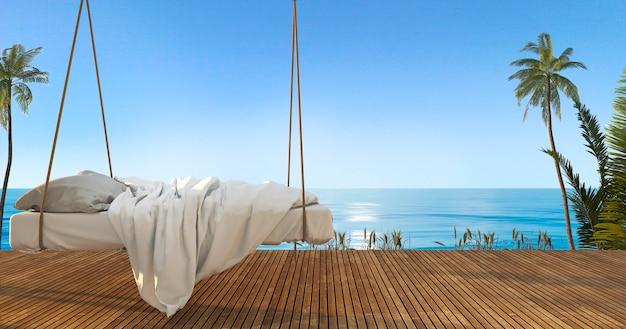 3 dレンダリングビーチと海の近くのテラスで美しいハンギングベッド Premium写真