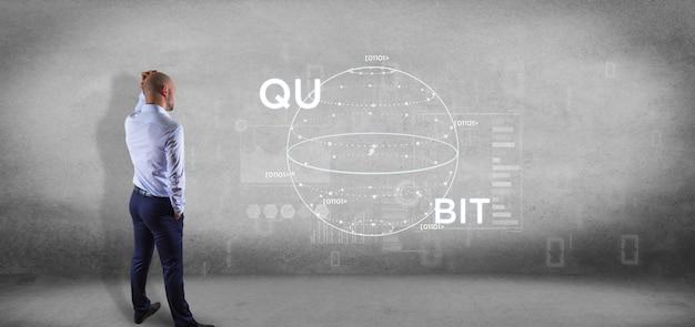 量子ビットアイコン3 dレンダリングと量子コンピューティングの概念と壁の前で実業家 Premium写真