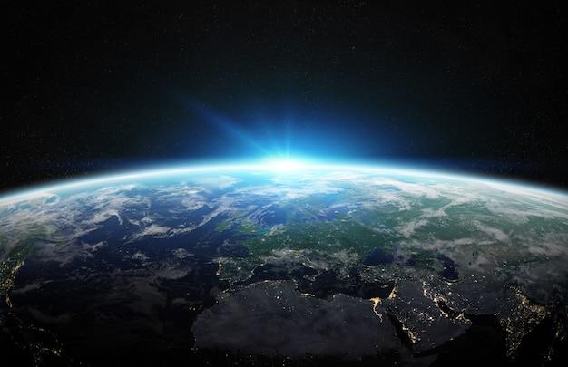 スペース3 dレンダリングで青い惑星地球の眺め Premium写真