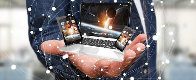 彼の手でノートパソコンの携帯電話とタブレットを保持している実業家3 dレンダリング Premium写真