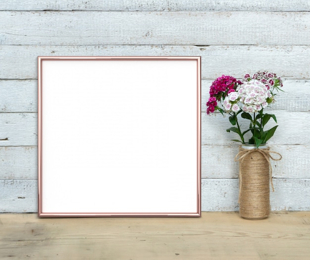 甘いウィリアムの3 dレンダリングの花束の近くのローズゴールドの正方形のフレーム。 Premium写真