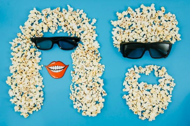 ポップコーンと映画館の概念のための3 dメガネのフラットレイアウト 無料写真