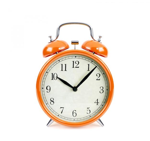 オレンジ色の目覚まし時計の分離、3 dレンダリング Premium写真