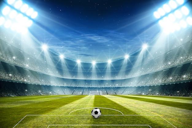 夜とフットボールスタジアムの照明3 dレンダリング Premium写真