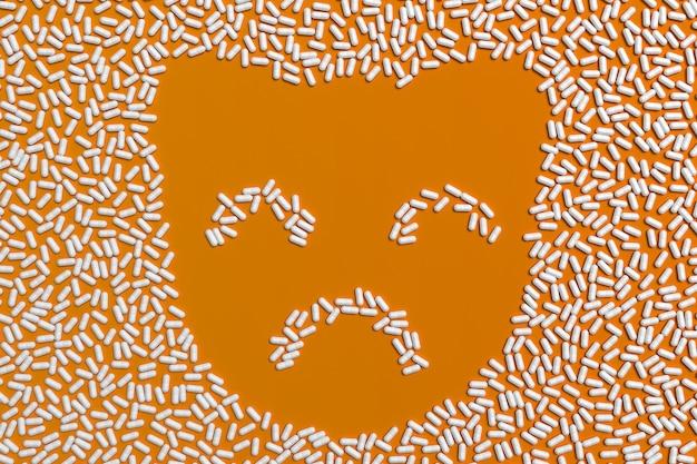 子猫のシルエットの形で多くの崩れた錠剤。 3 dイラスト Premium写真
