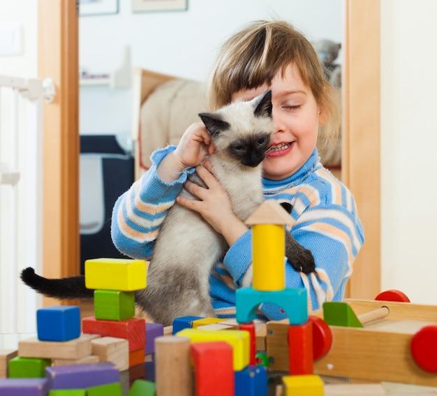 3 years child  with kitten Free Photo