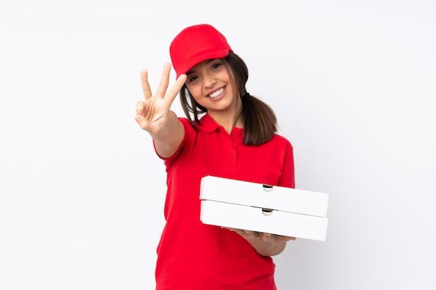 若いピザ配達女性幸せと指で3つを数える Premium写真