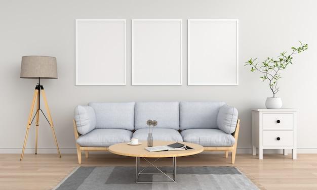 リビングルームで3つの空の空白のフォトフレーム Premium写真