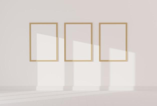空の白い部屋のモックアップのための3つの空のフォトフレーム Premium写真