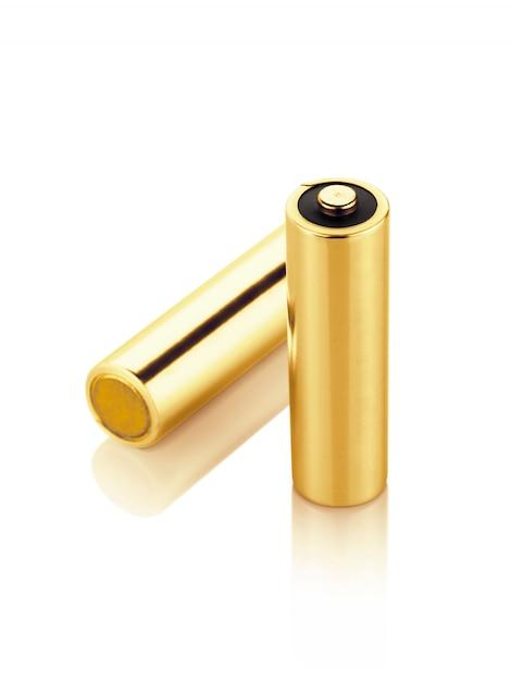 メタリックゴールドアルカリ電池単3形絶縁 Premium写真