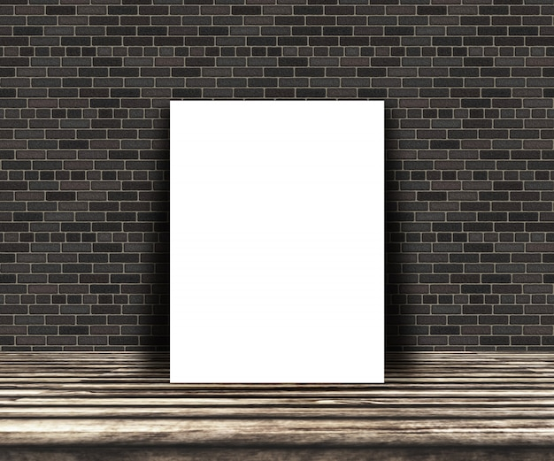3D blank picture on a wooden table leaning against a brick wall Free Photo