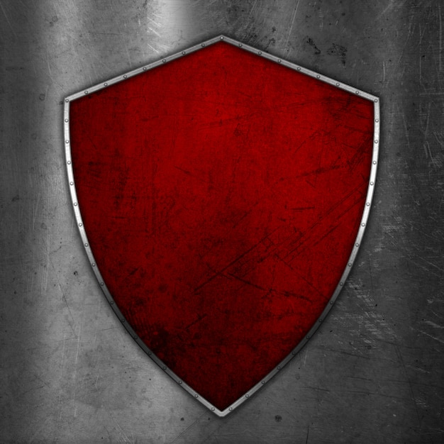 3d grunge shield on scratched metal background Free Photo