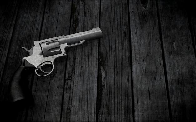3d handgun on a grunge wooden texture Free Photo