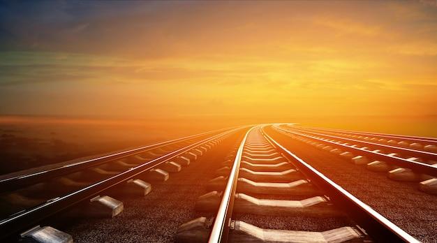 3d illustration of empty railways on sunset sky background Premium Photo