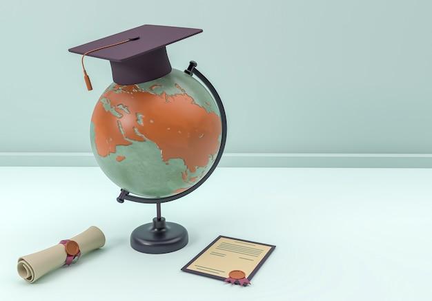3d иллюстрации. кепка и диплом с земным шаром Premium Фотографии